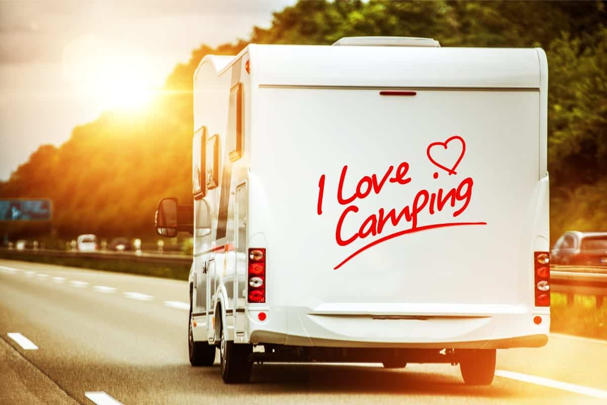 camper driving into the sunset